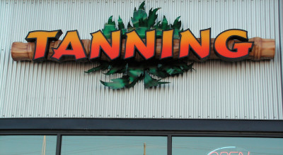 Tanning Company Sign